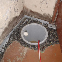 Installing a sump in a sump pump liner in a Victoria home