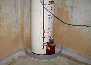 A water heater in Sidney that's been protected by the FloodRing® and a perimeter drain system.