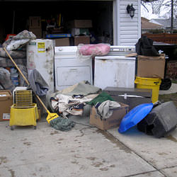 Soaked, wet personal items sitting in a driveway, including a washer and dryer in Courtenay.