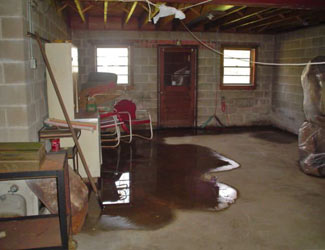 a flooded basement floor in a Black Creek home