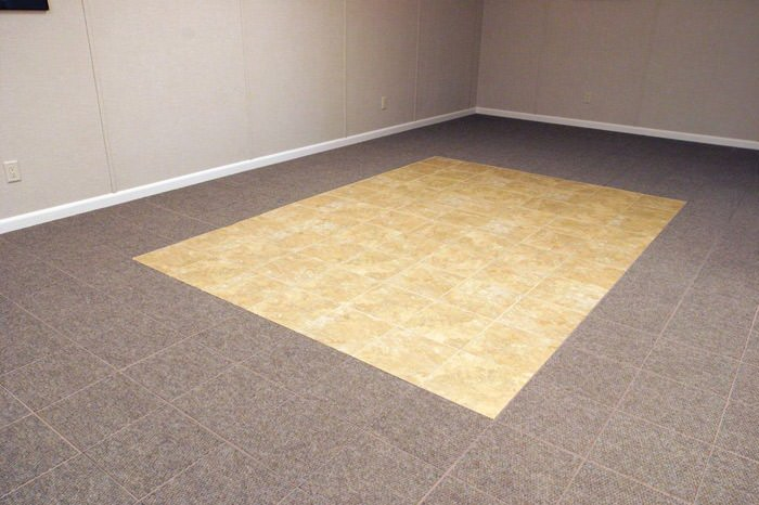 tiled and carpeted basement flooring installed in a Duncan home