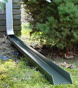 Gutter downspout extension installed in Black Creek