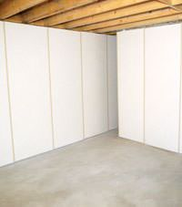 Unfinished basement insulated wall covering in Esquimalt, British Columbia